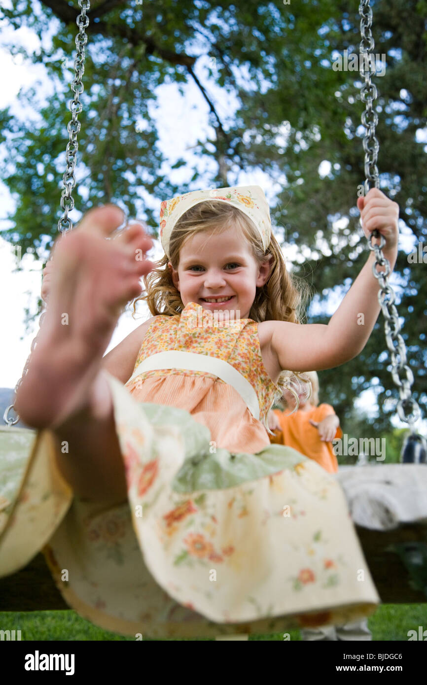 girl on a swing - Stock Image