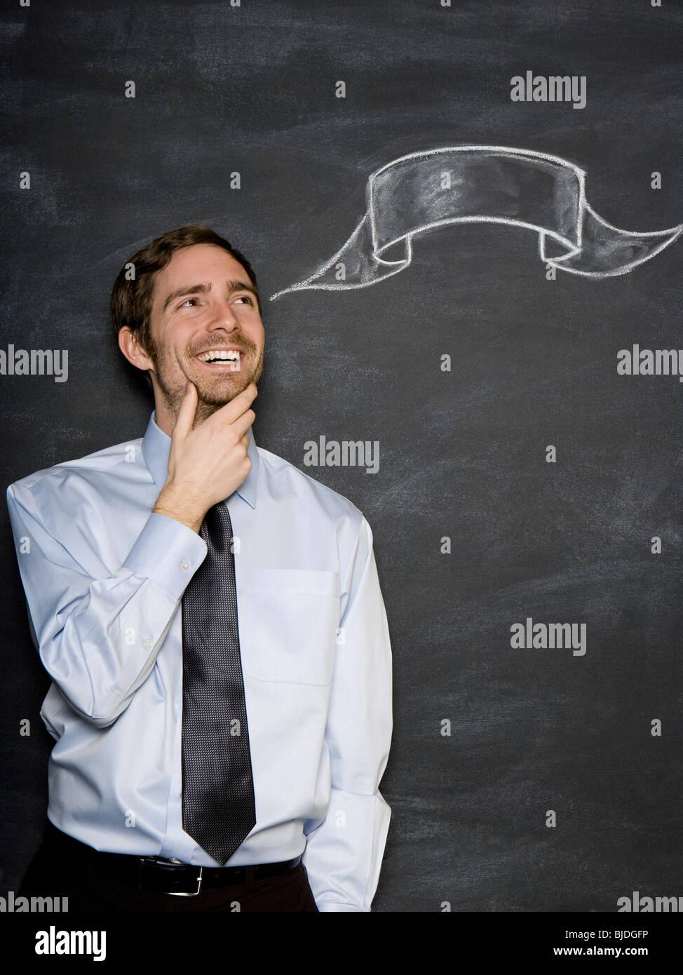 man against a blackboard - Stock Image