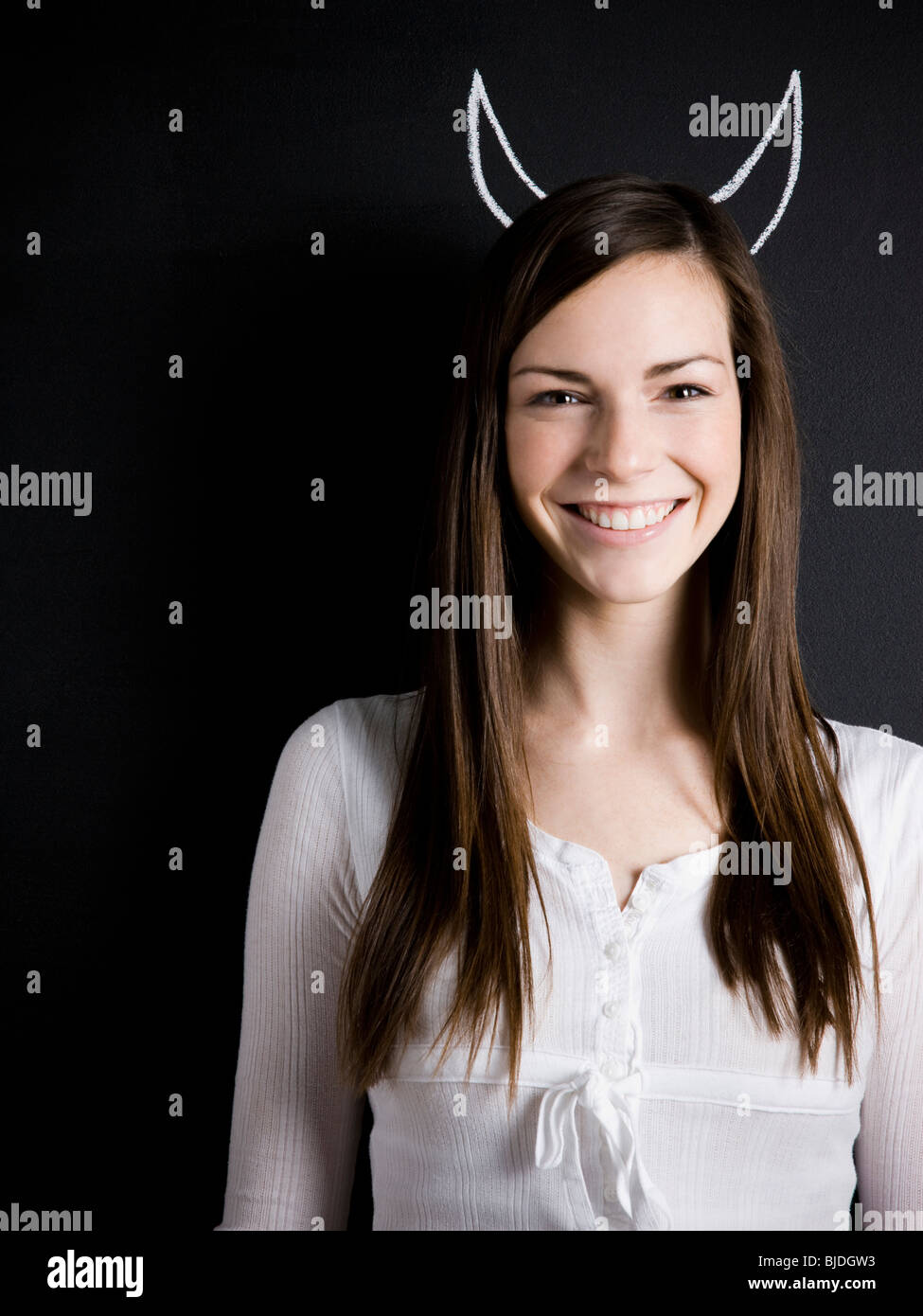 young woman against a chalkboard Stock Photo
