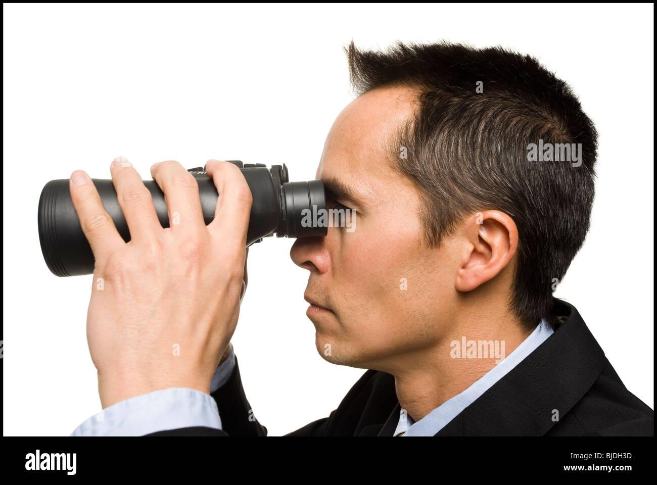 businessperson with binoculars - Stock Image