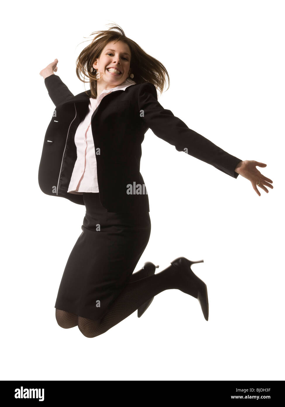 businesswoman jumping in the air - Stock Image