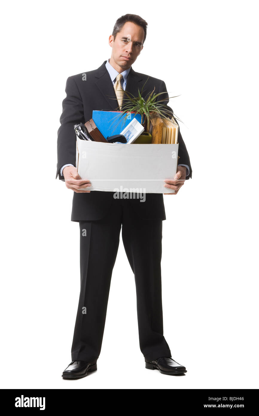 businessperson clearing out things Stock Photo