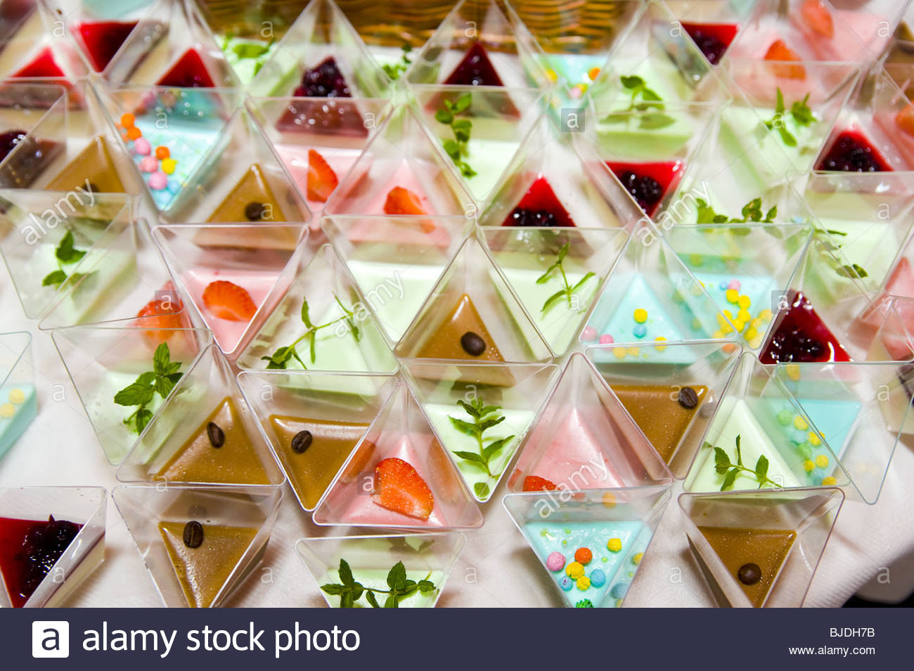 Fancy desserts in triangle containers - Stock Image