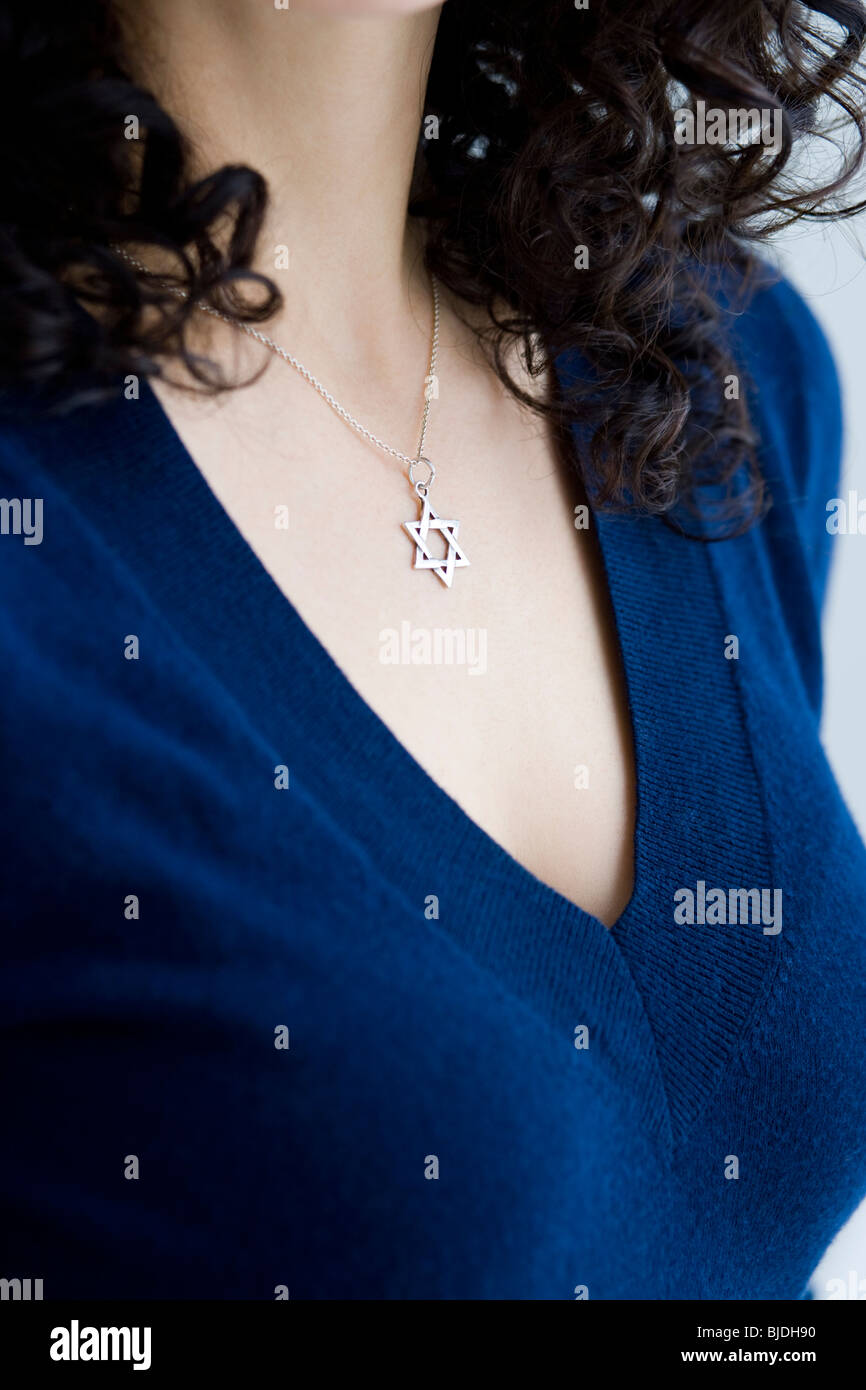 woman wearing a star of david necklace Stock Photo