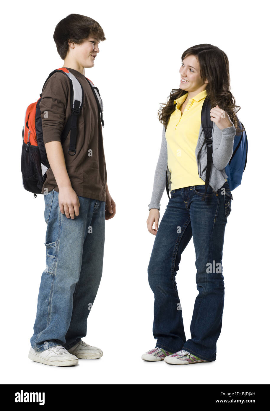 Students with book bags posing - Stock Image