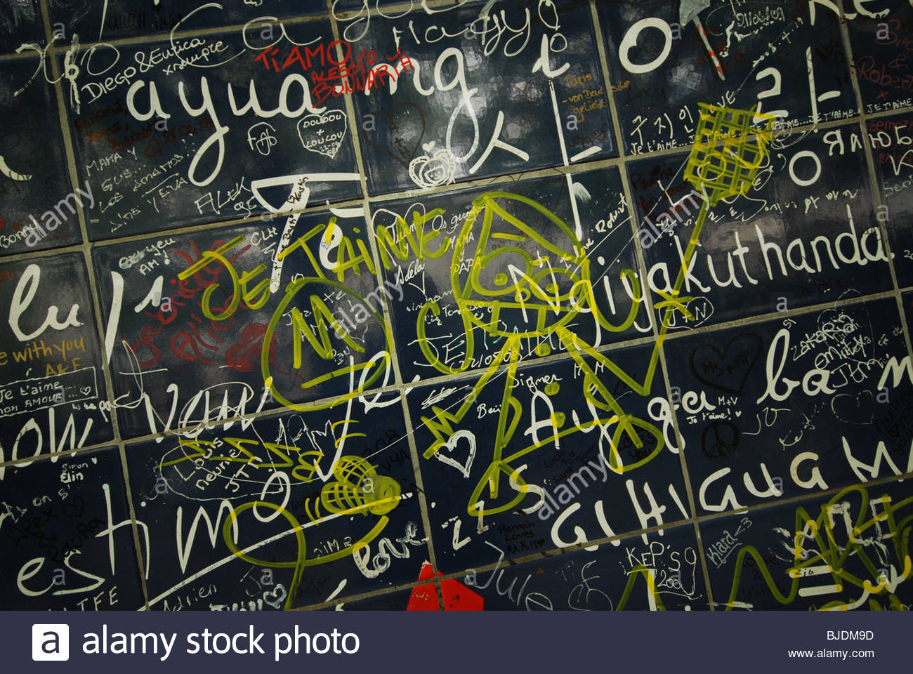 vandalised detail of Love Wall near Place des Abbesses Montmartre Paris France - Stock Image