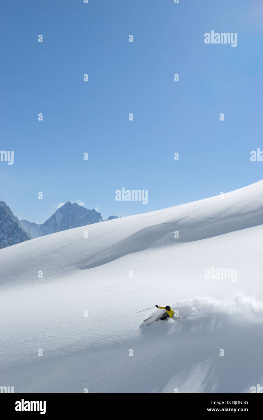 Skiing in fresh powder snow, Chamonix, France - Stock Image