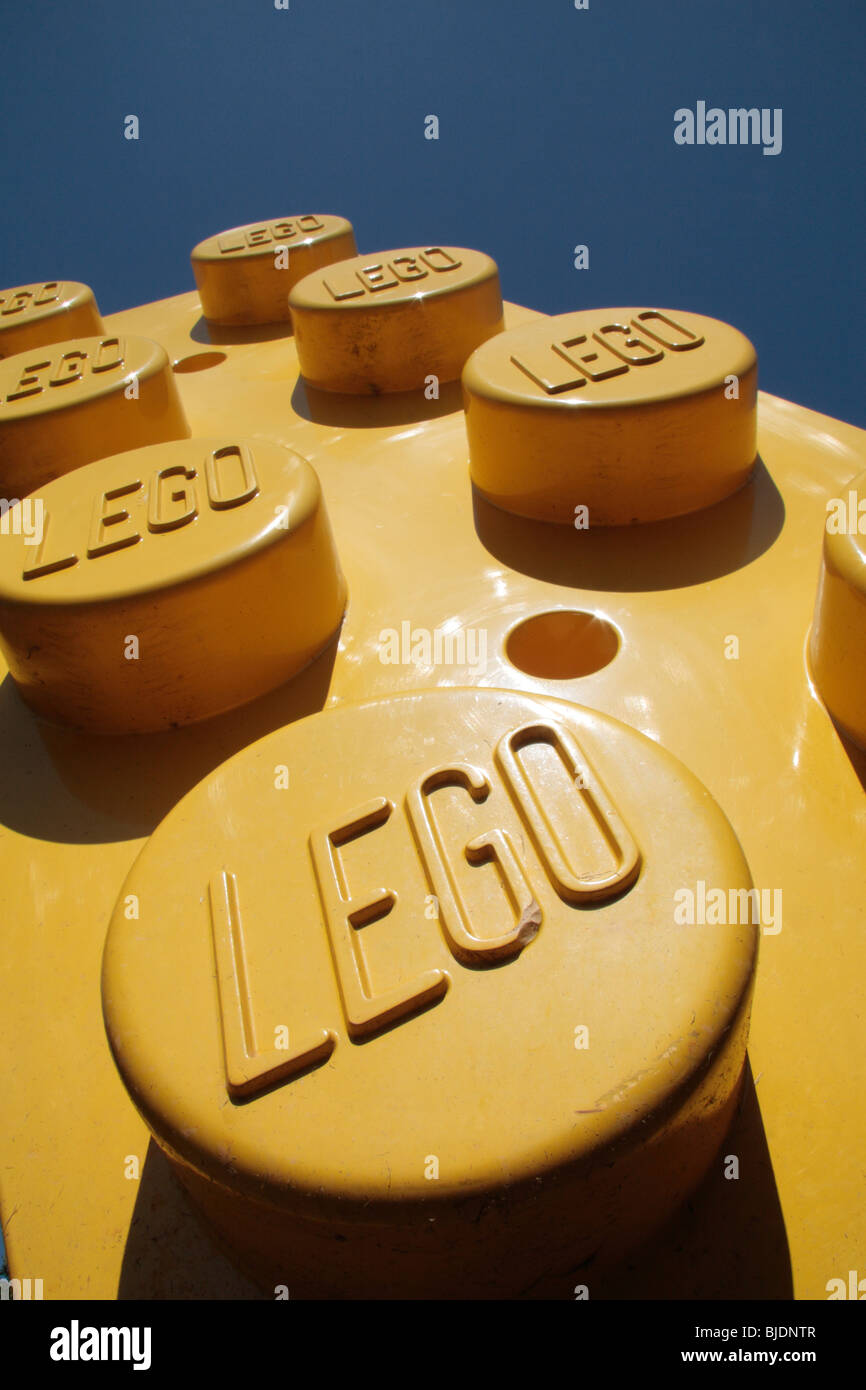 Close up of the Lego branding on giant red, yellow & blue Lego