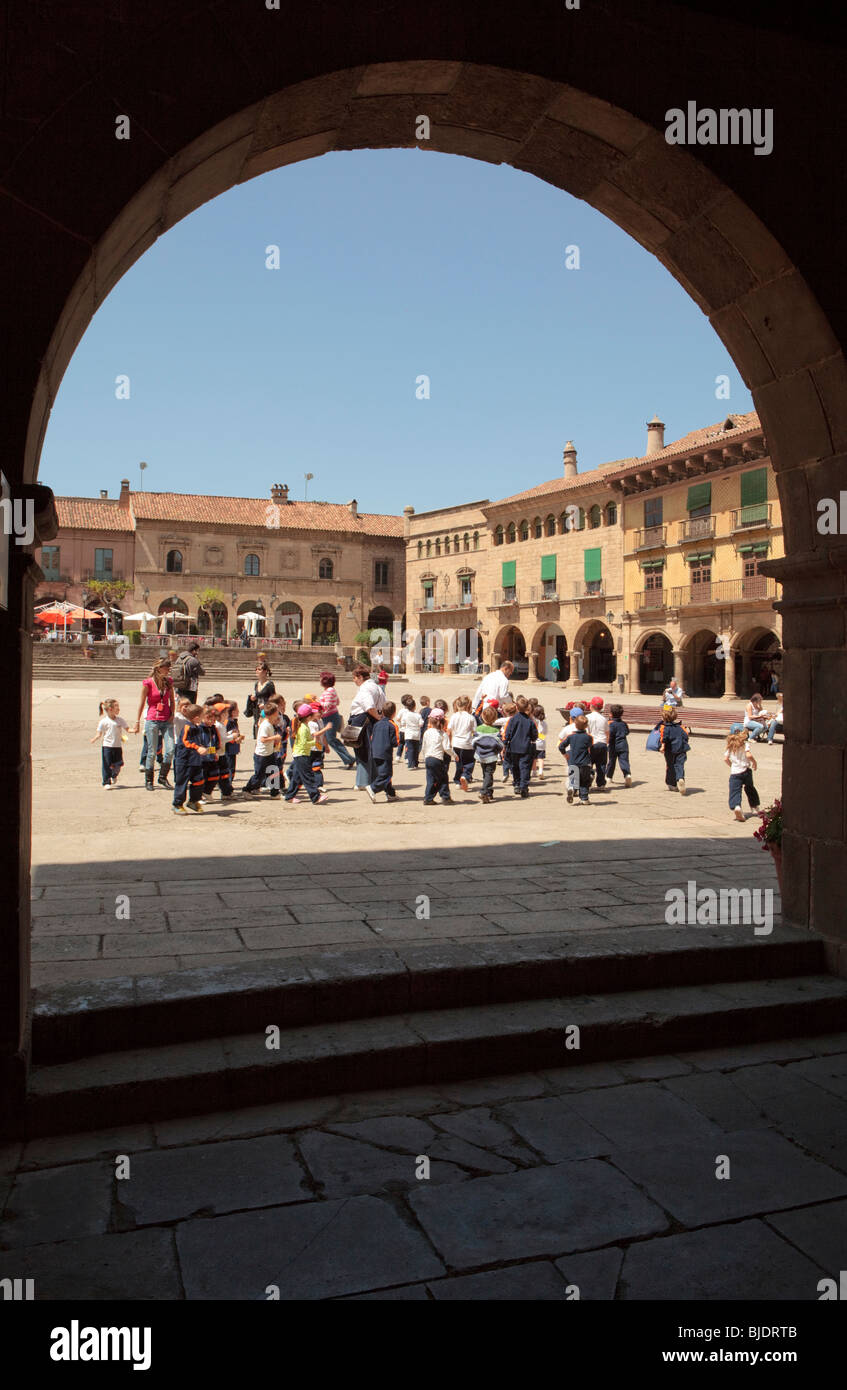School trip visits The Poble Espanyol, a village with a collection of 117 replicas buildings from different parts - Stock Image