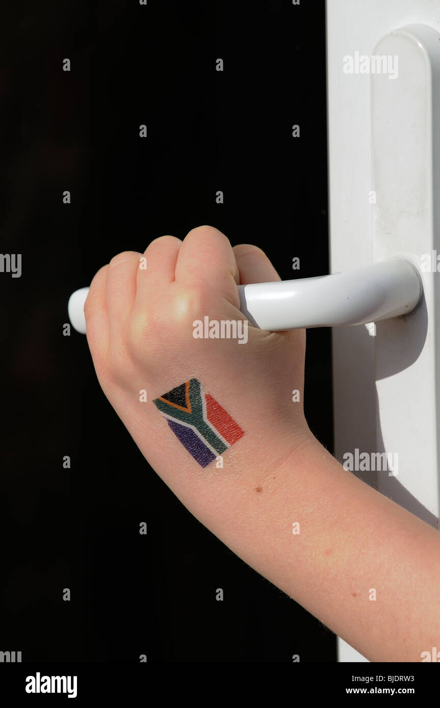 d8f72583515c3 Childs hand with tattoo of South African flag opening a door Stock ...