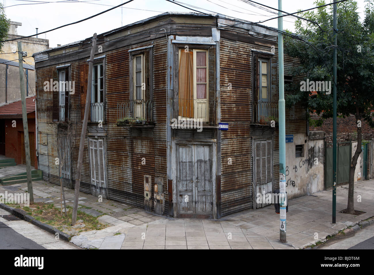 old dilapidated house made of wood and corrugated iron in la boca capital federal buenos aires republic of argentina - Stock Image