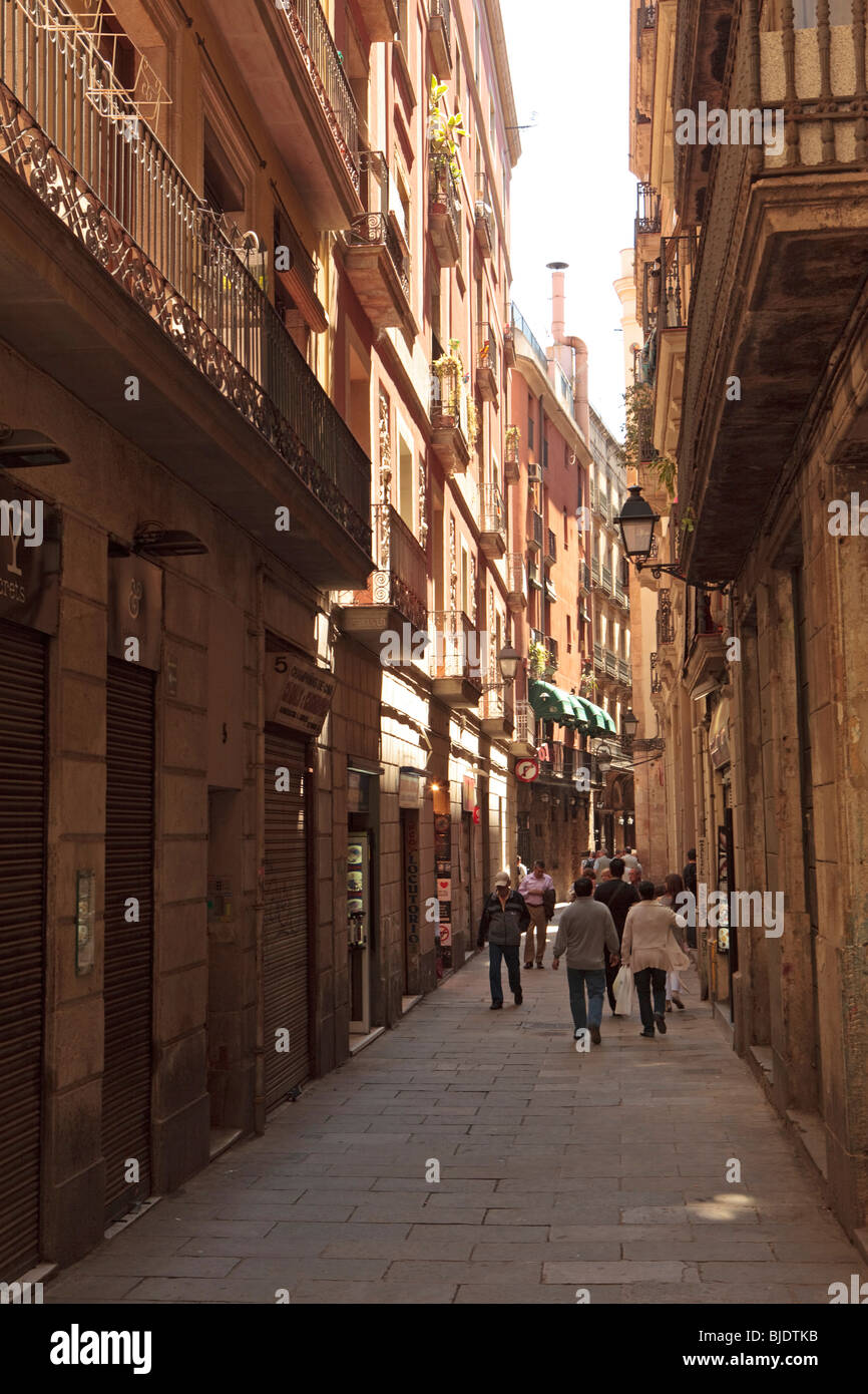 Narrow street with high rise housing accommodation in Barcelona. - Stock Image