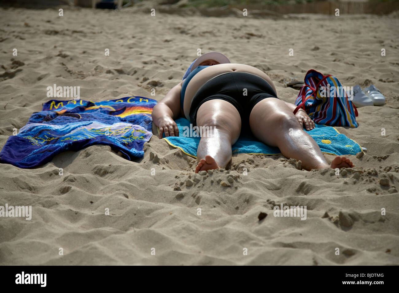 an obsese sunbather - Stock Image