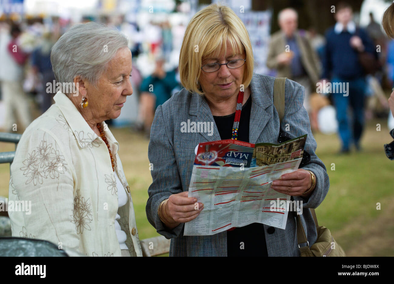 Eisteddfod visitor Ann Clwyd MP studying map of festival site, National Eisteddfod of Wales Newport Gwent South - Stock Image