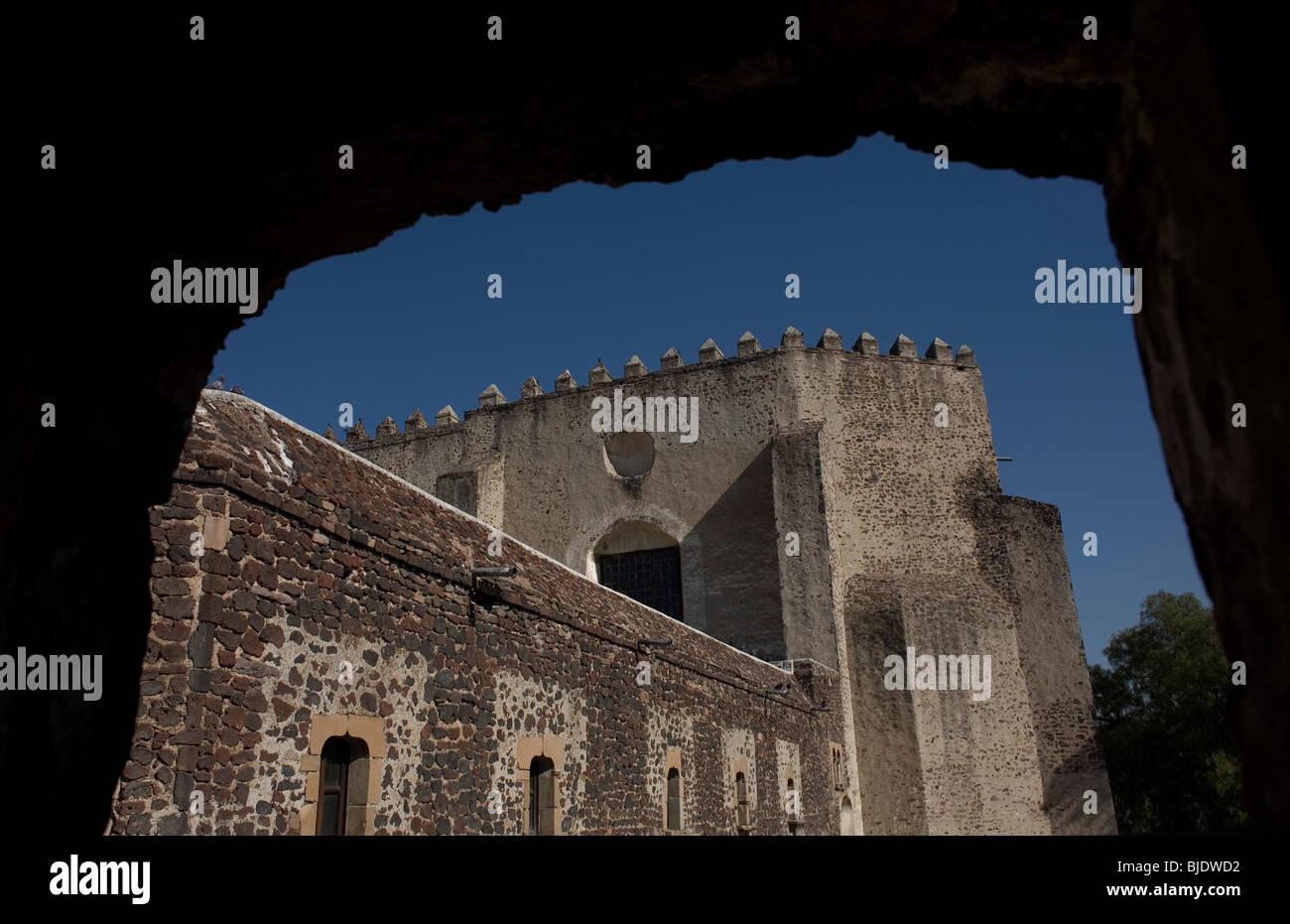 The back of the church of the ex convent San Agustin Acolman is seen trought a window in Acolman, Mexico City Stock Photo