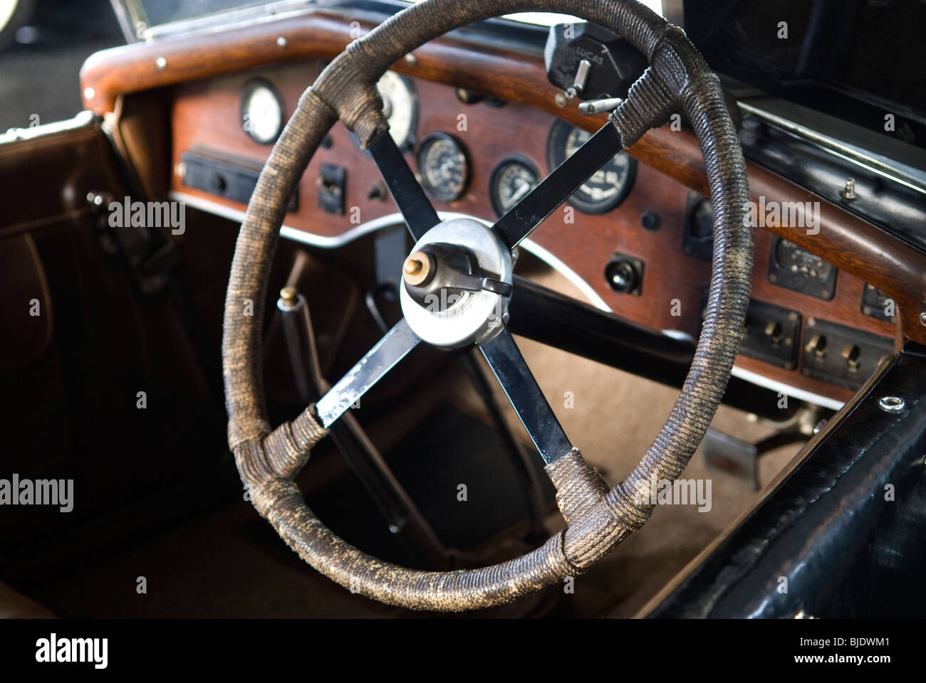 A Steering Wheel Of An Old Classic Car Wooden Dashboard Stock Photo
