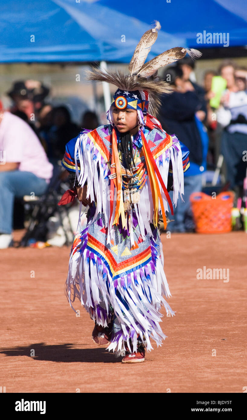 Native American dancers in traditional regalia perform during a Pow Wow. - Stock Image