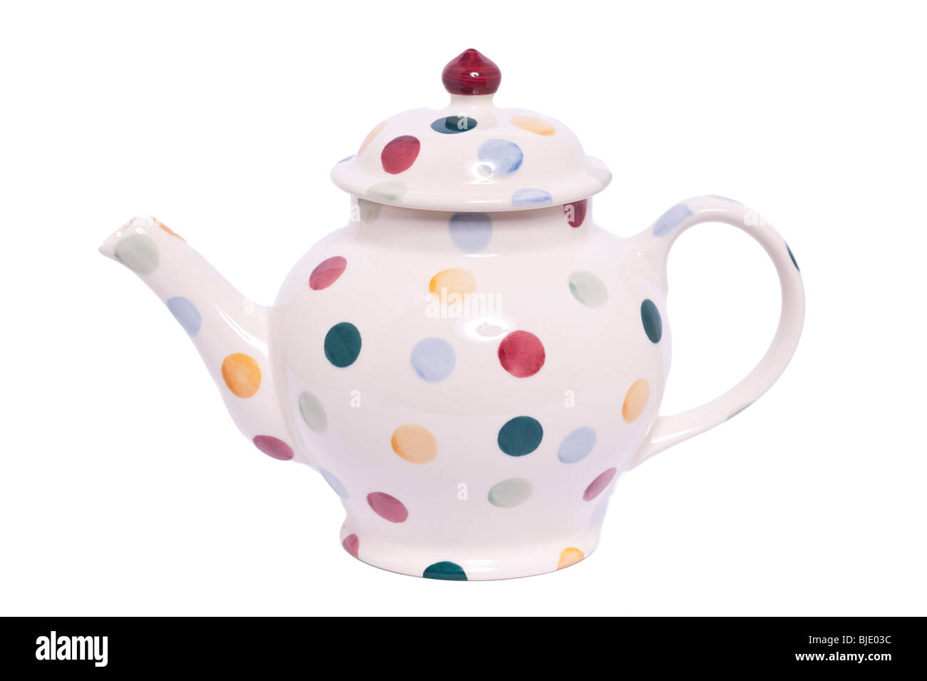 A Polka dot patterned pot by Emma Bridgewater decorated by hand on a white background - Stock Image