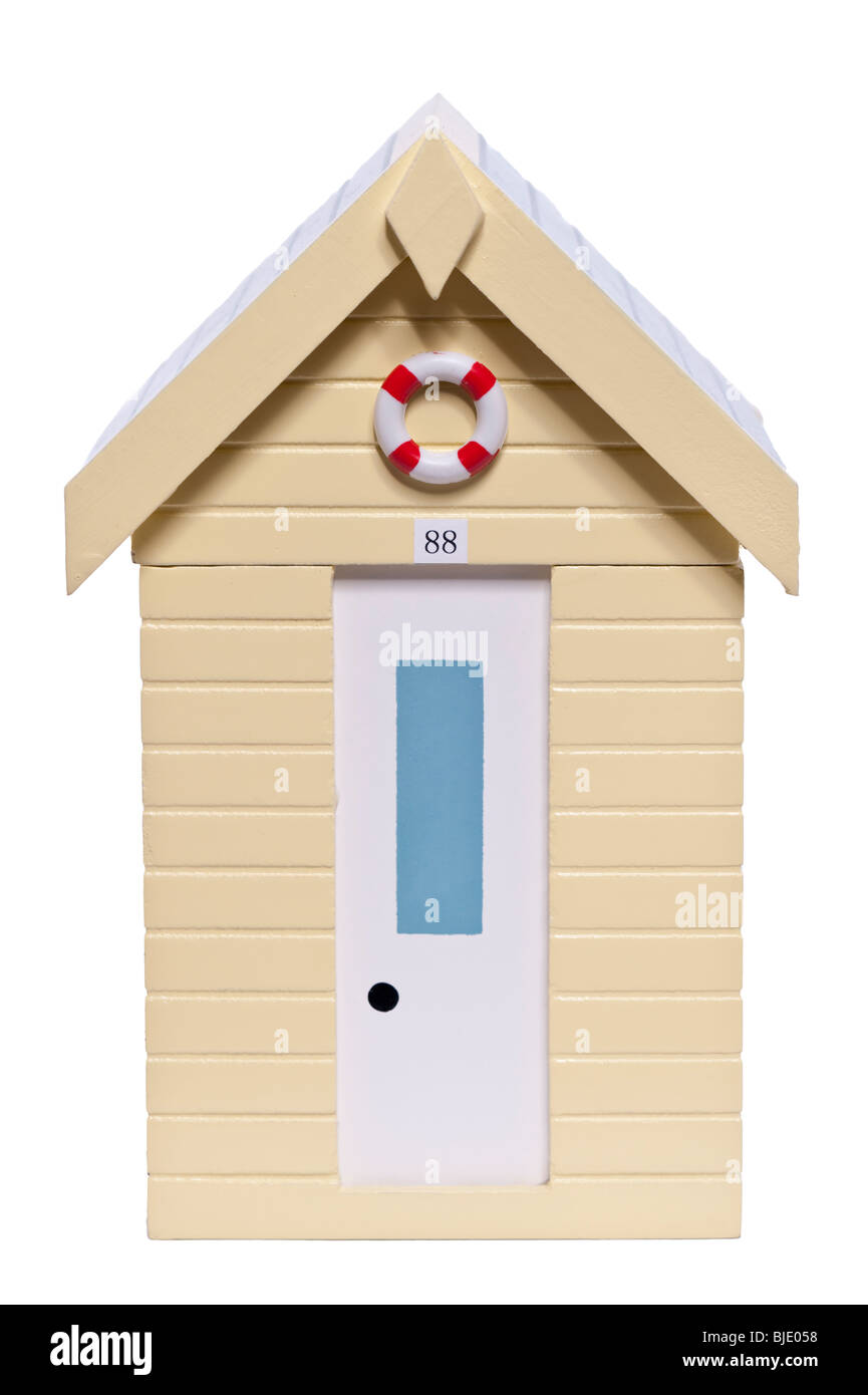 A wooden model of a beach hut on a white background - Stock Image