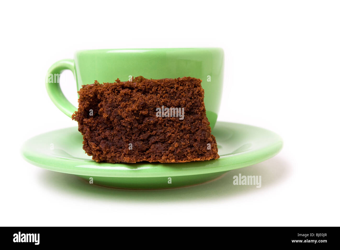 Chocolate fudge brownie with cup of espresso coffee - Stock Image