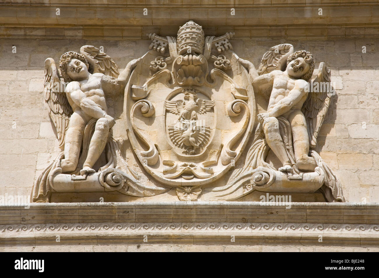 Avignon, Provence, France. Coat of arms of Pope Paul V carved on façade of the Hôtel des Monnaies, the - Stock Image
