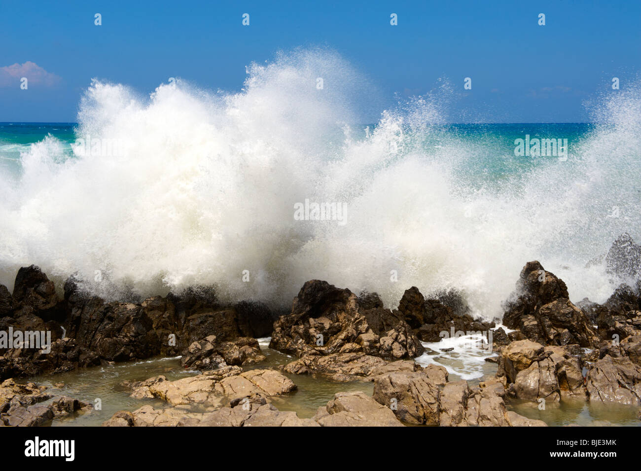 waves crashing on the rocks at Cefalu [Cefaú] Sicily - Stock Image