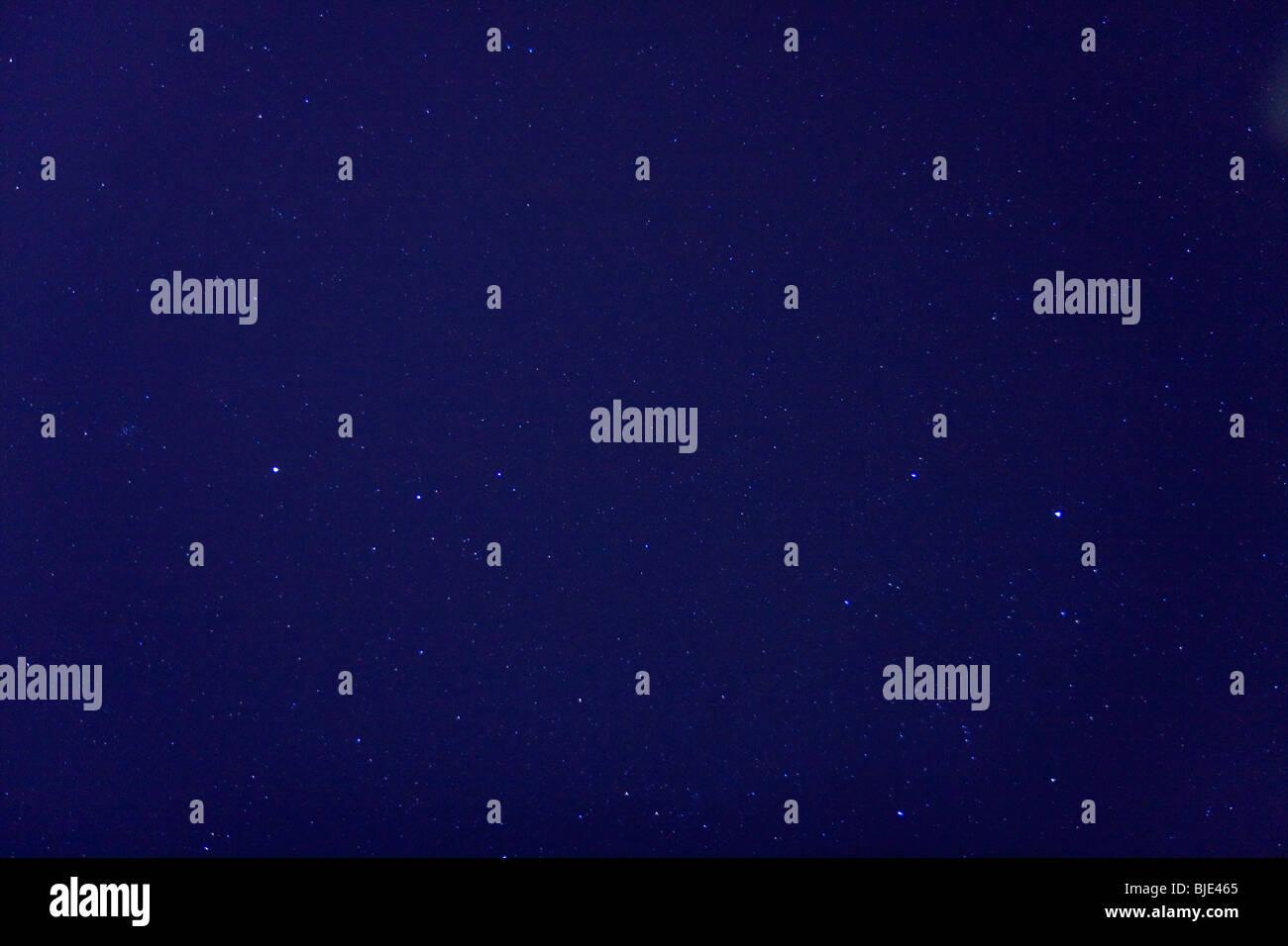 Stars on a clear, dark blue, night sky. - Stock Image
