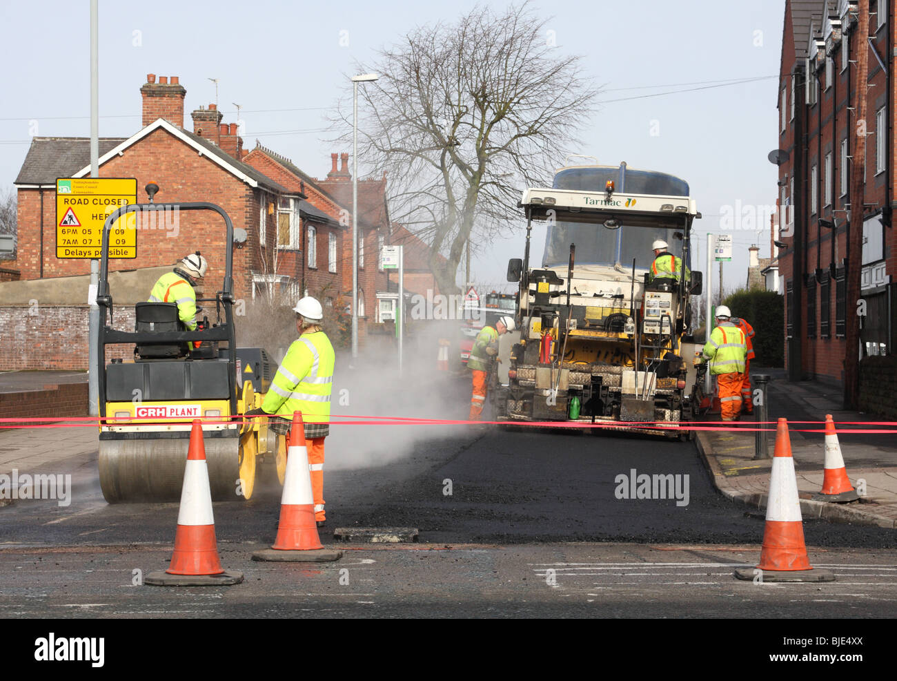 Workers relaying Tarmac on a road in the U.K. - Stock Image