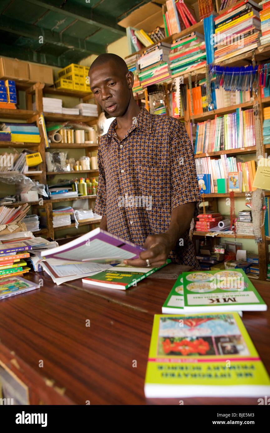 Employee in an educational bookstore in Soroti, Uganda. - Stock Image