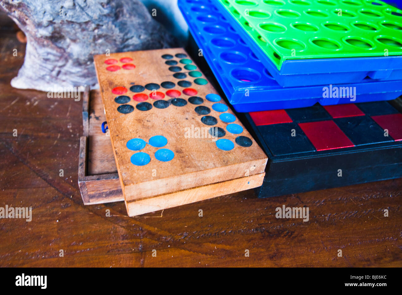 Travel image of various bar entertainment board games from Koh Lanta, an island outside Phuket, in Thailand. - Stock Image