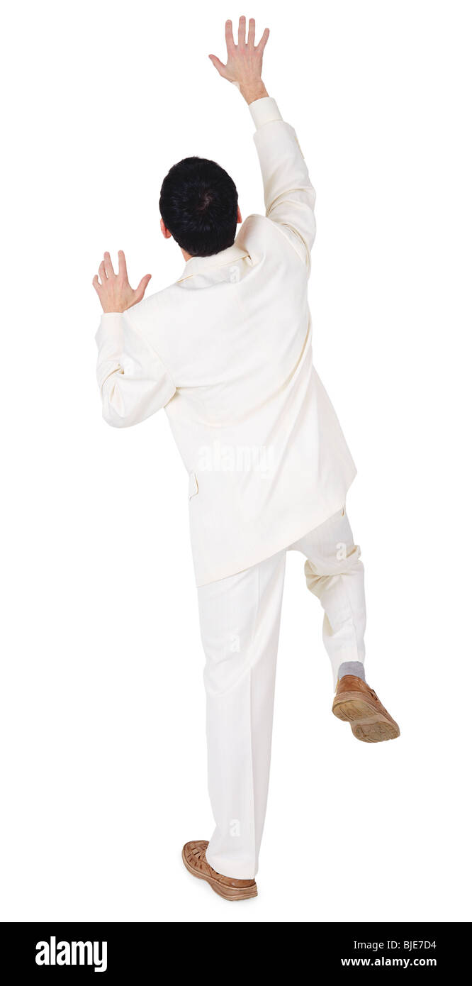 Man tries to reach something high, isolated on a white background - Stock Image