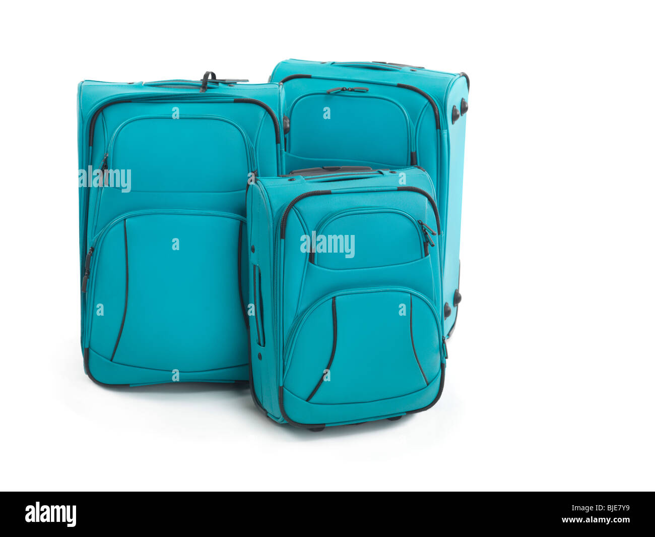 Three blue suitcases isolated on white background - Stock Image