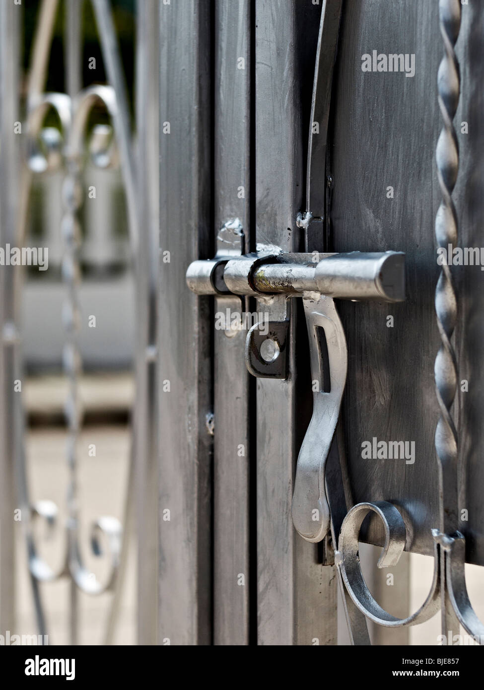 Steel Sliding Bolt Lock On A Security Gate Stock Photo