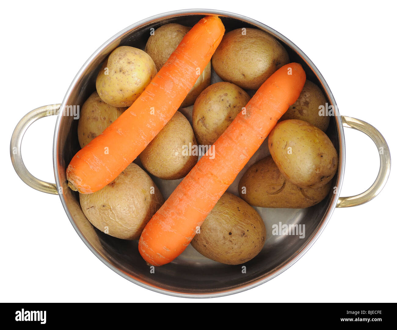 Cooking pot with carrots and potatoes isolated over white background - Stock Image