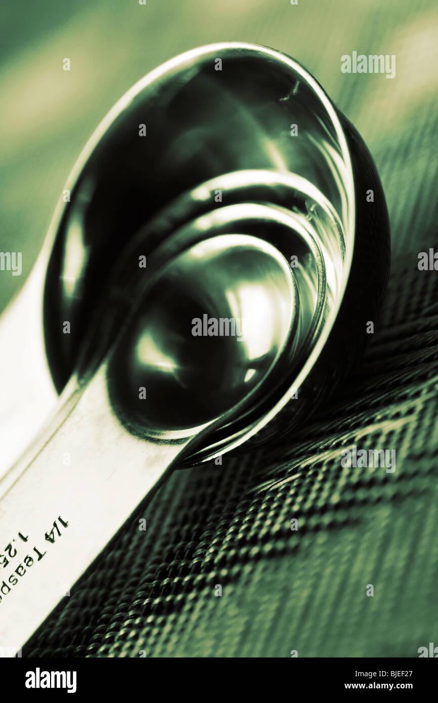 cross processed measuring spoons with shallow depth of field - Stock Image