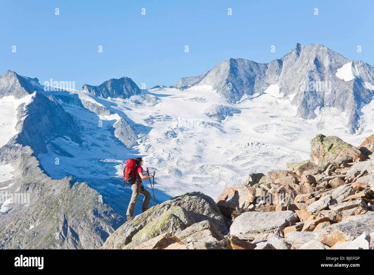 Mountain climber in Zillertal Alps, Tyrol, Austria, side view - Stock Image