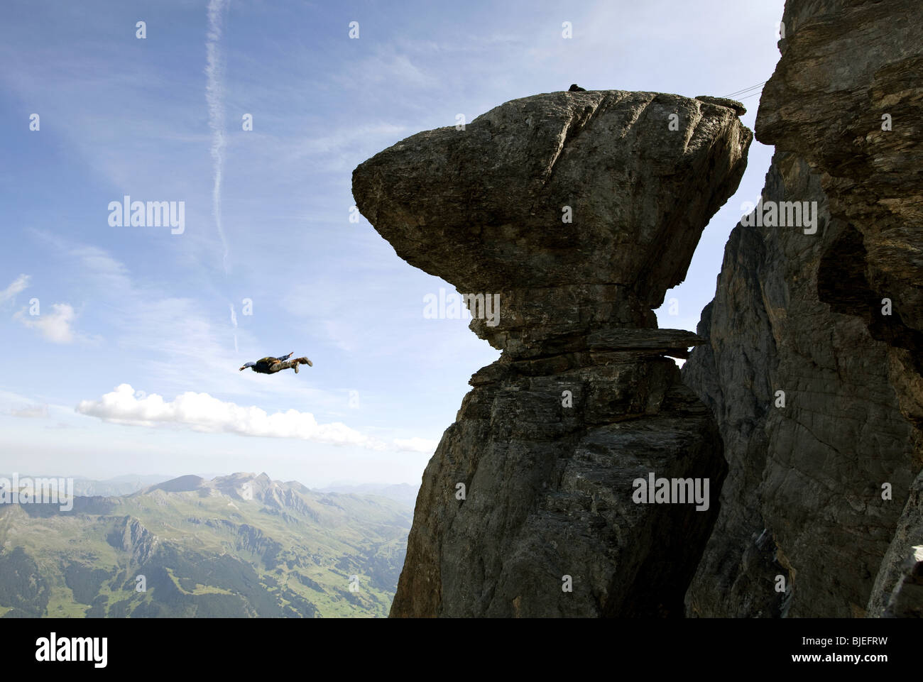 Basejumper free falling, Eiger North Face, Switzerland - Stock Image