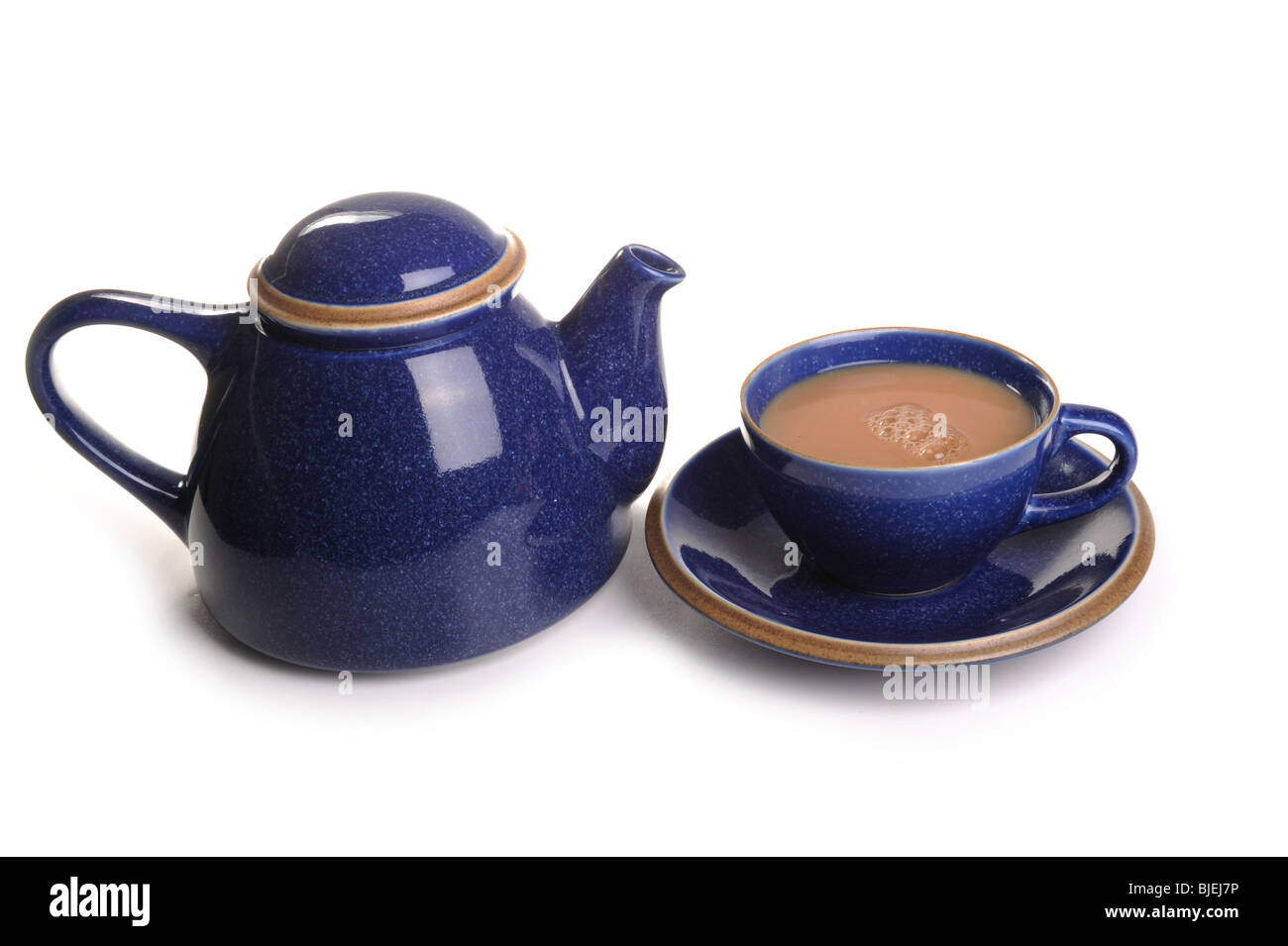Tea Pot and a cup of tea photographed in studio - Stock Image