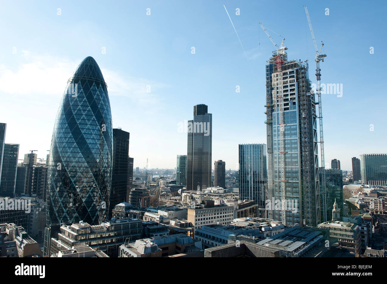 The City of London with views of the Gherkin and Nat West Tower and new construction work being carried out - Stock Image