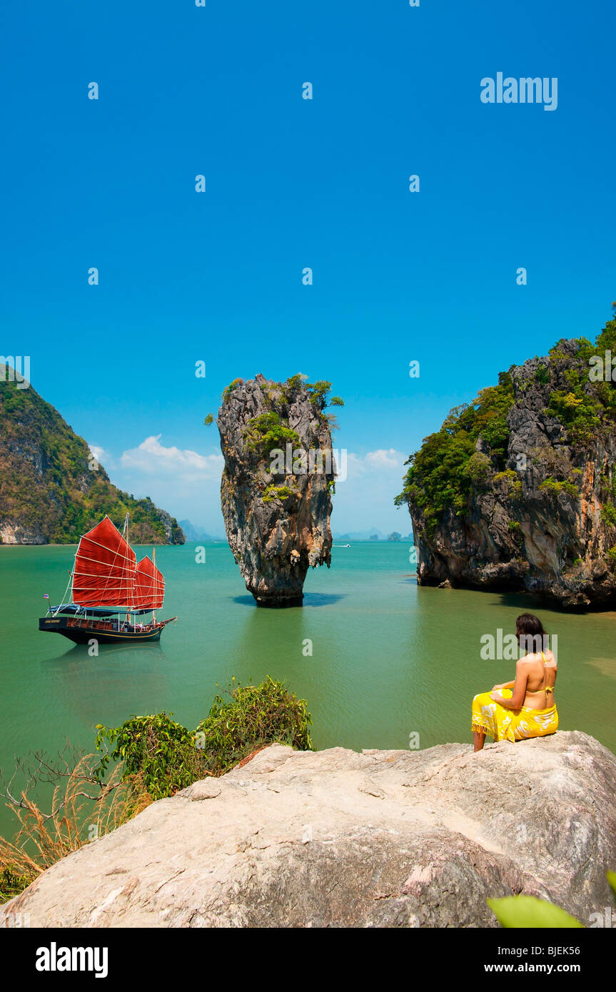 Junk and woman on rock, Phang-Nga, Thailand - Stock Image