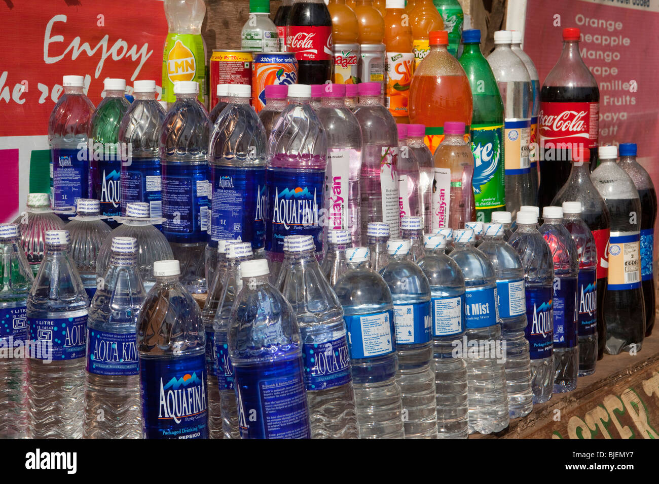 India, Kerala, Varkala, tourist shop selling bottled drinking water and soft drinks in plastic bottles Stock Photo