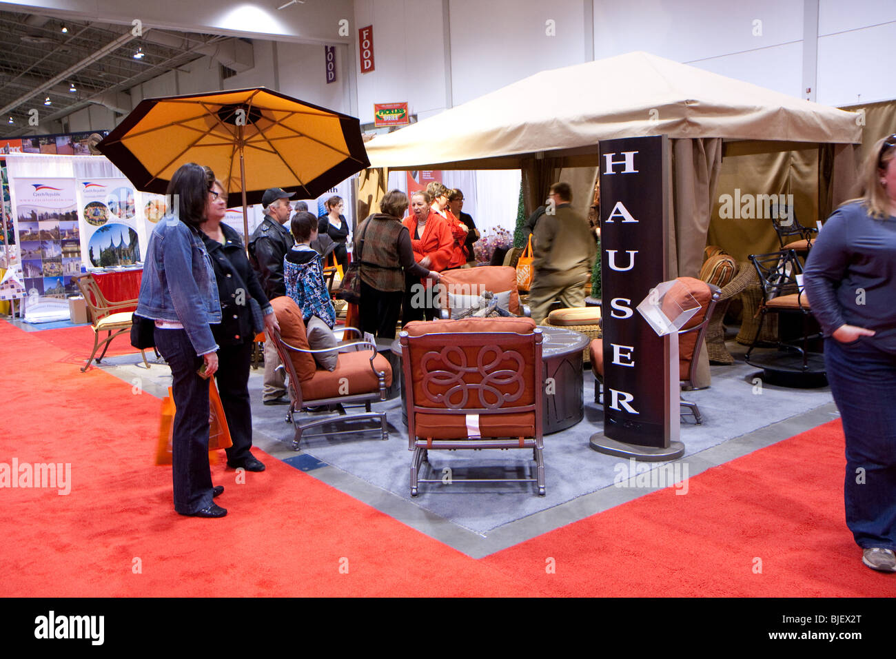Shoppers Passing By A Booth Selling Outdoor Patio Furnitures For The Spring  Season