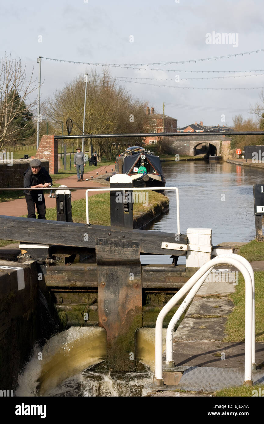 Lock Keeper opening lock gate paddles at Stone, Staffordshire - Stock Image