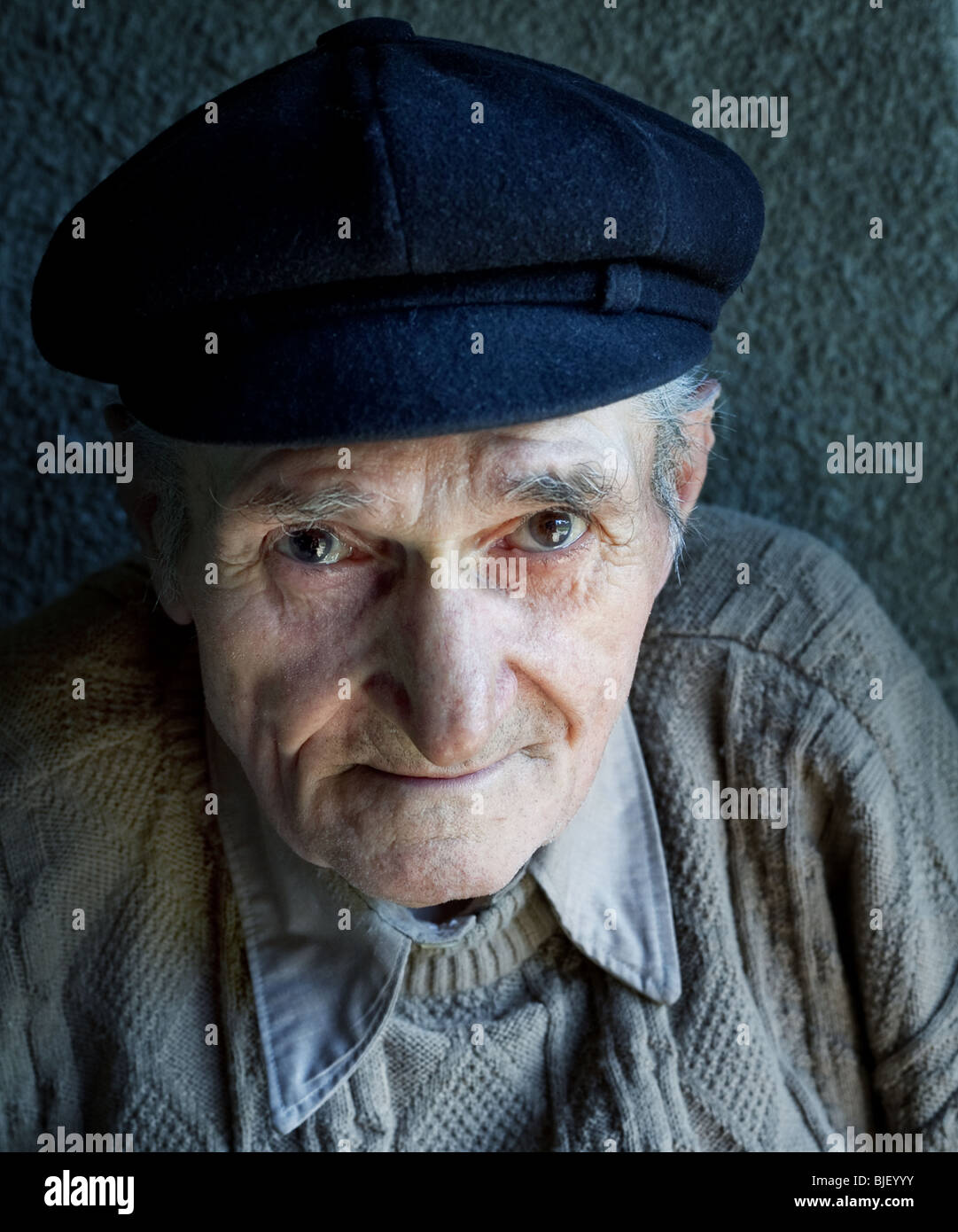 Portrait of friendly senior man - Stock Image