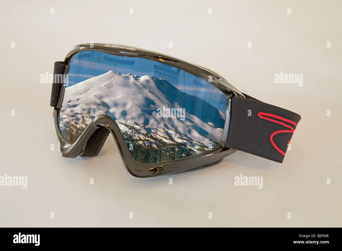 Ski goggles with the reflection of a ski resort mountain - Stock Image