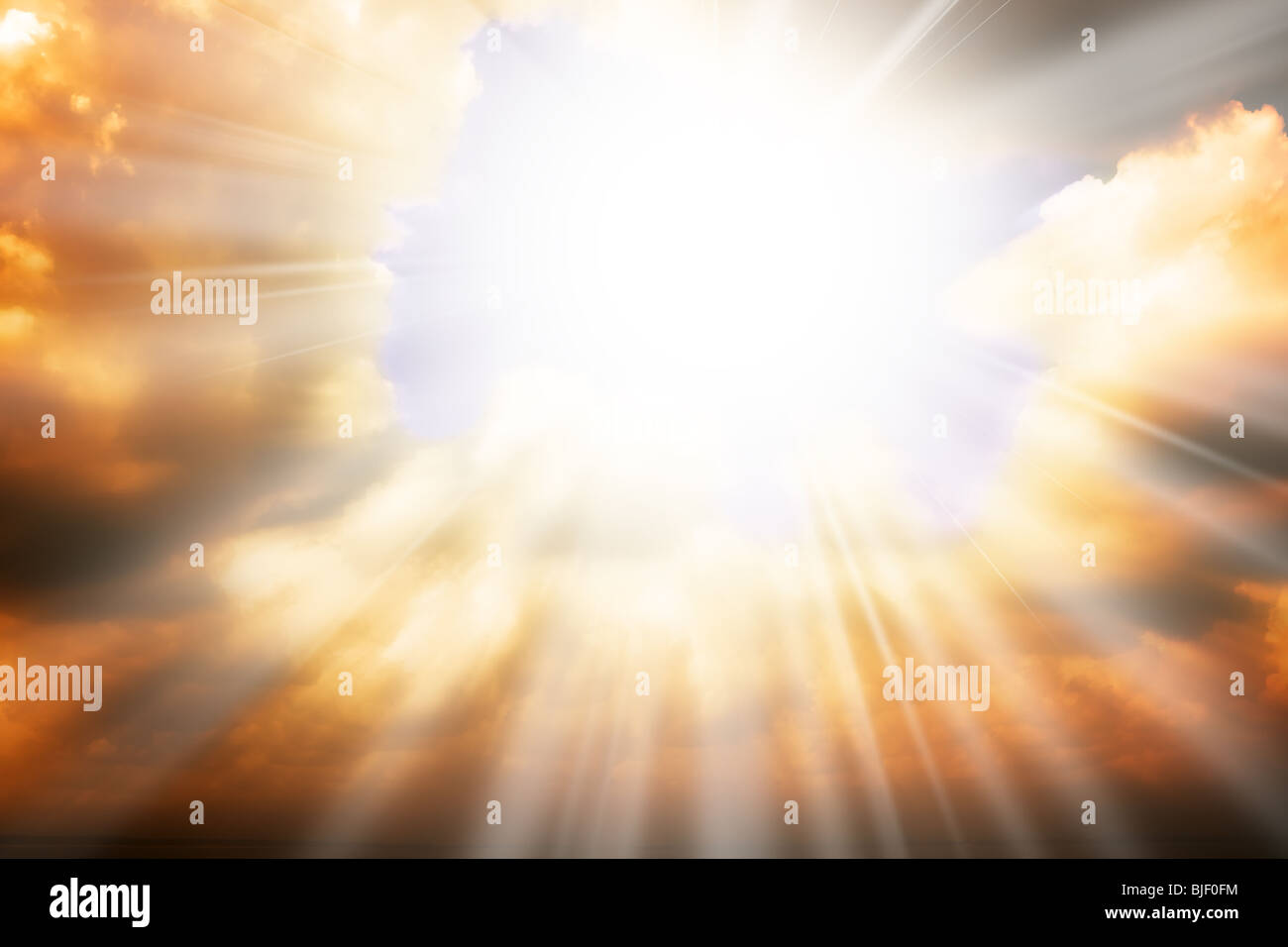 Heaven sky background with sun light and clouds - Stock Image