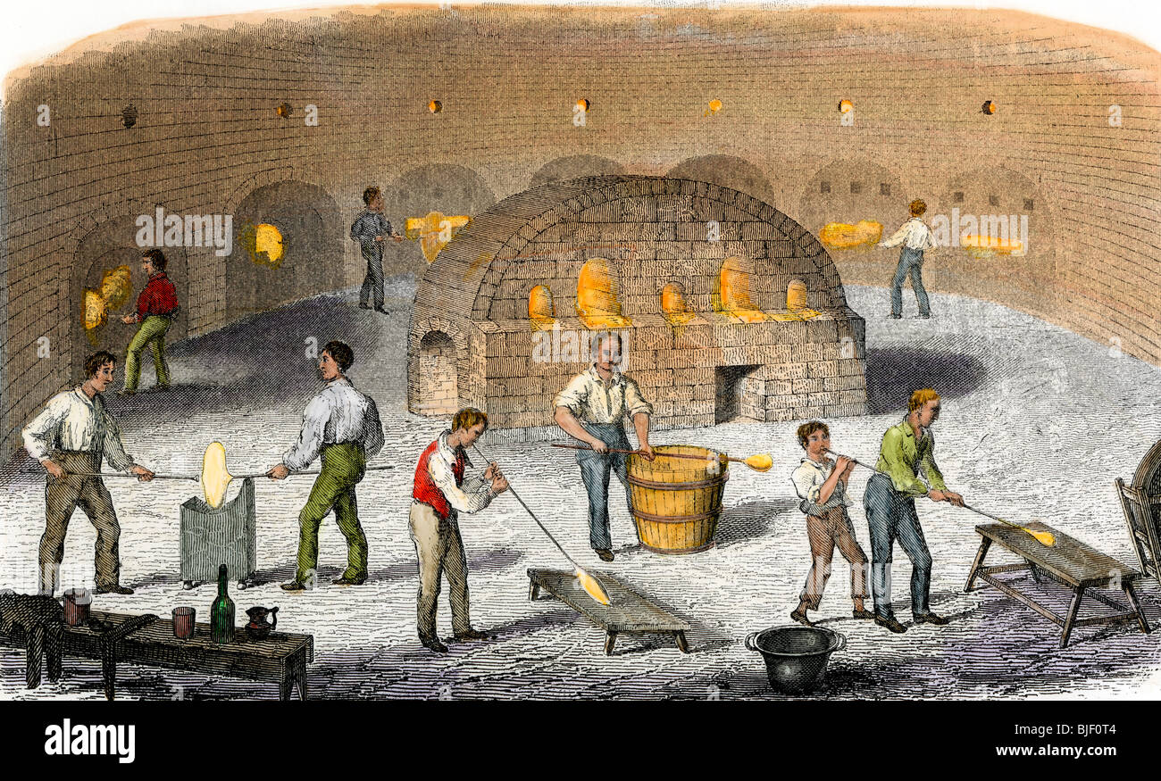 Workers in a crown-glass factory, Great Britain, early 1800s. Hand-colored woodcut - Stock Image
