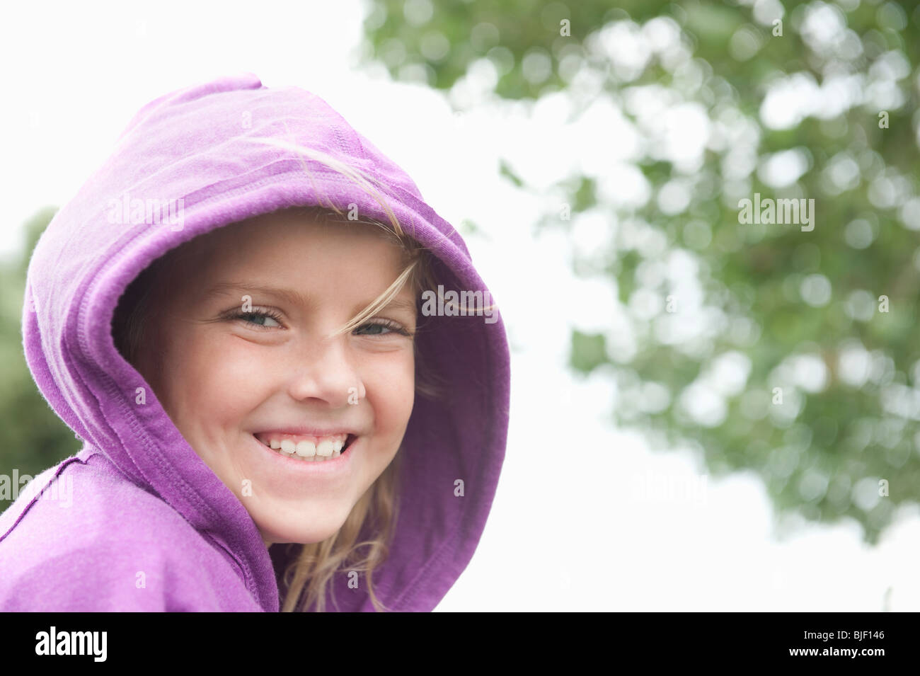 Portrait of a girl in a purple hooded top - Stock Image