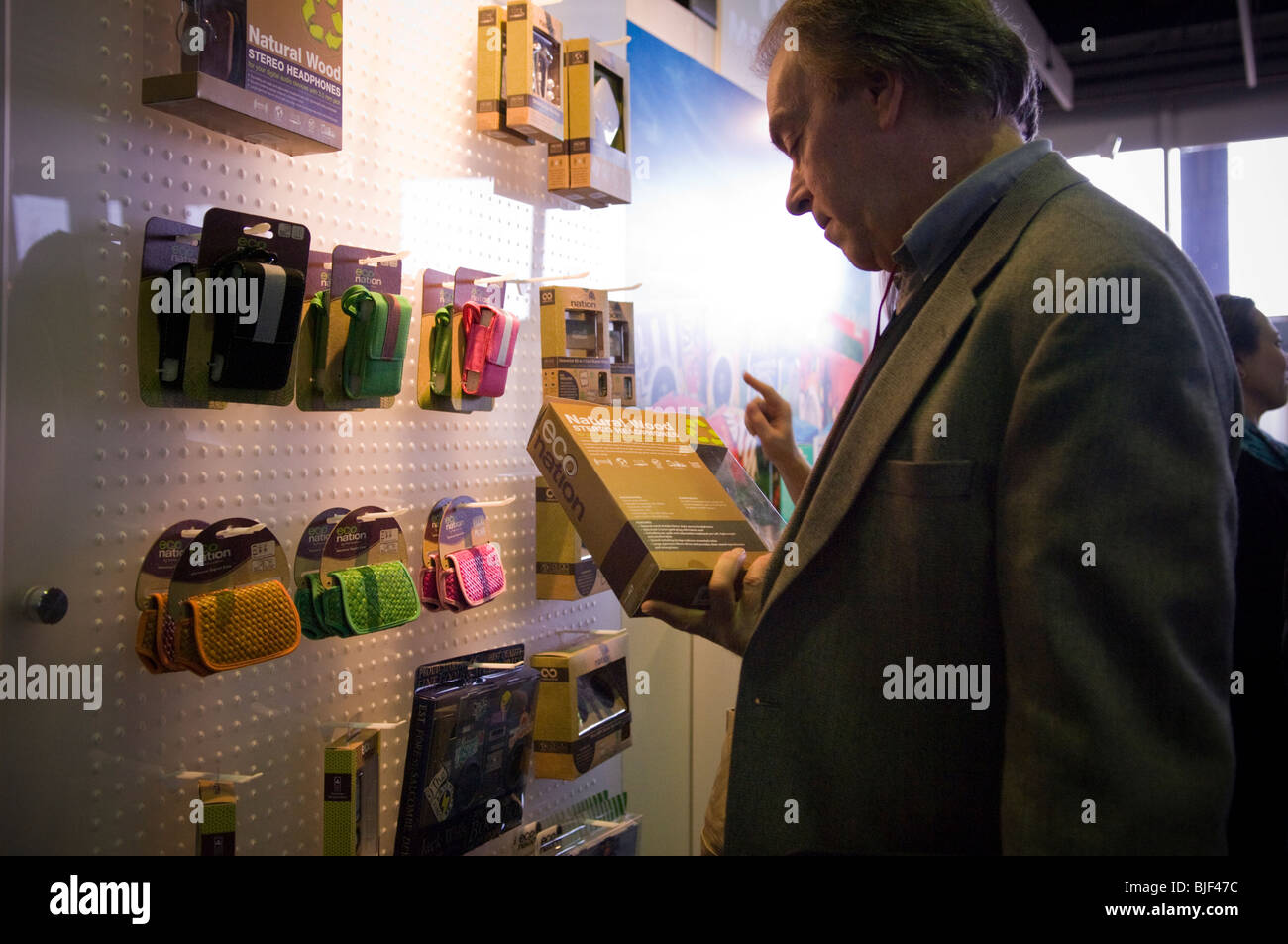 A visitor examines products by Econation at the Go Green Expo held in midtown in New York - Stock Image