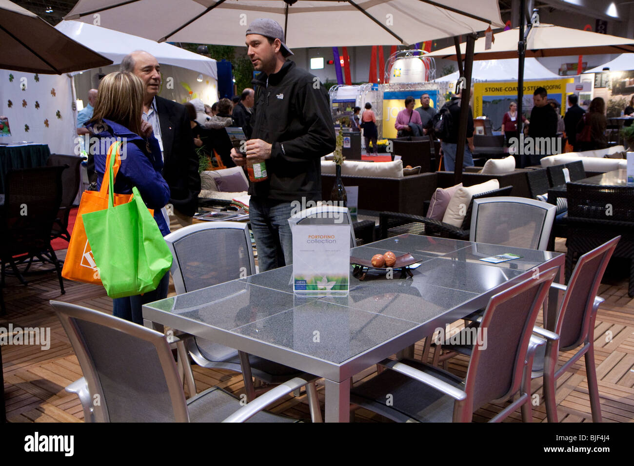 Canada bloom buy buyers buying couple event flower furniture garden patio sales salesman sell shop shopper shoppers - Stock Image